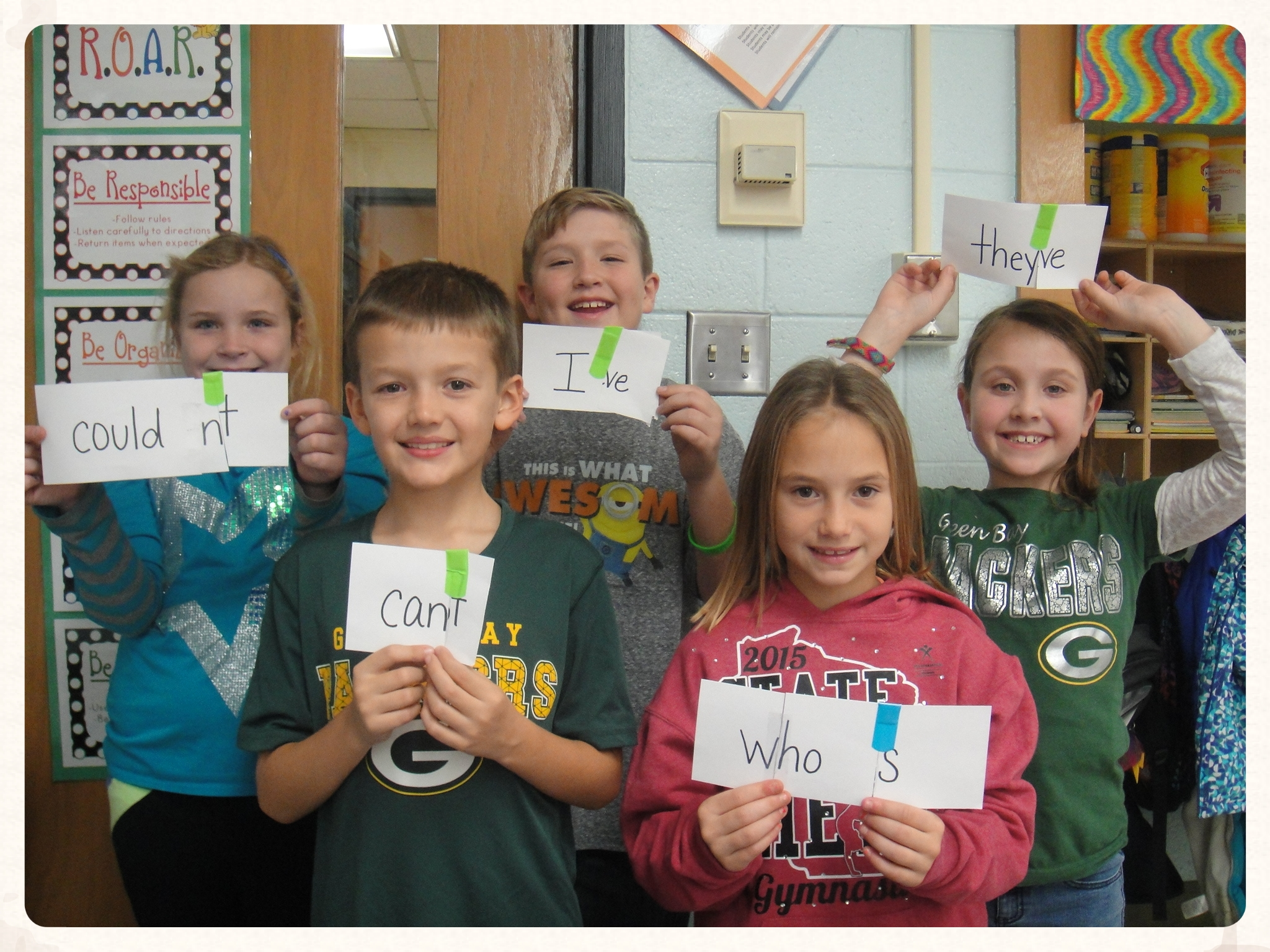 Carollton students holding up spelling words
