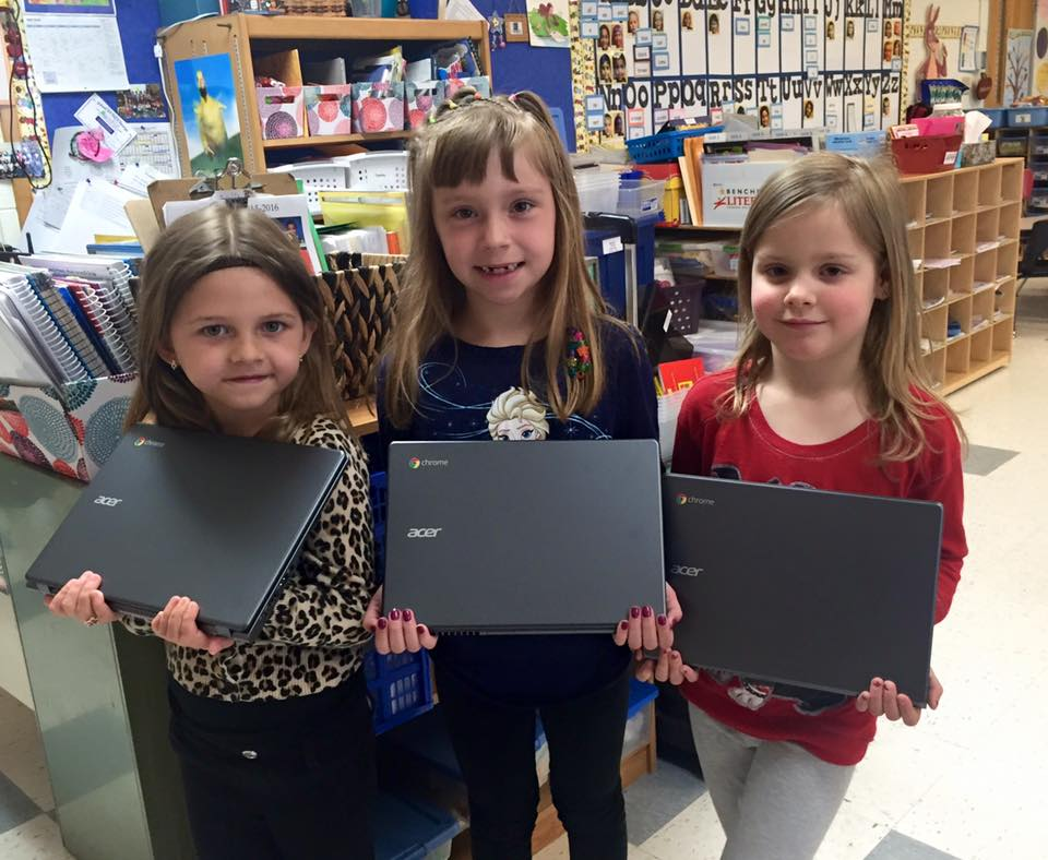 Three students with chromebooks