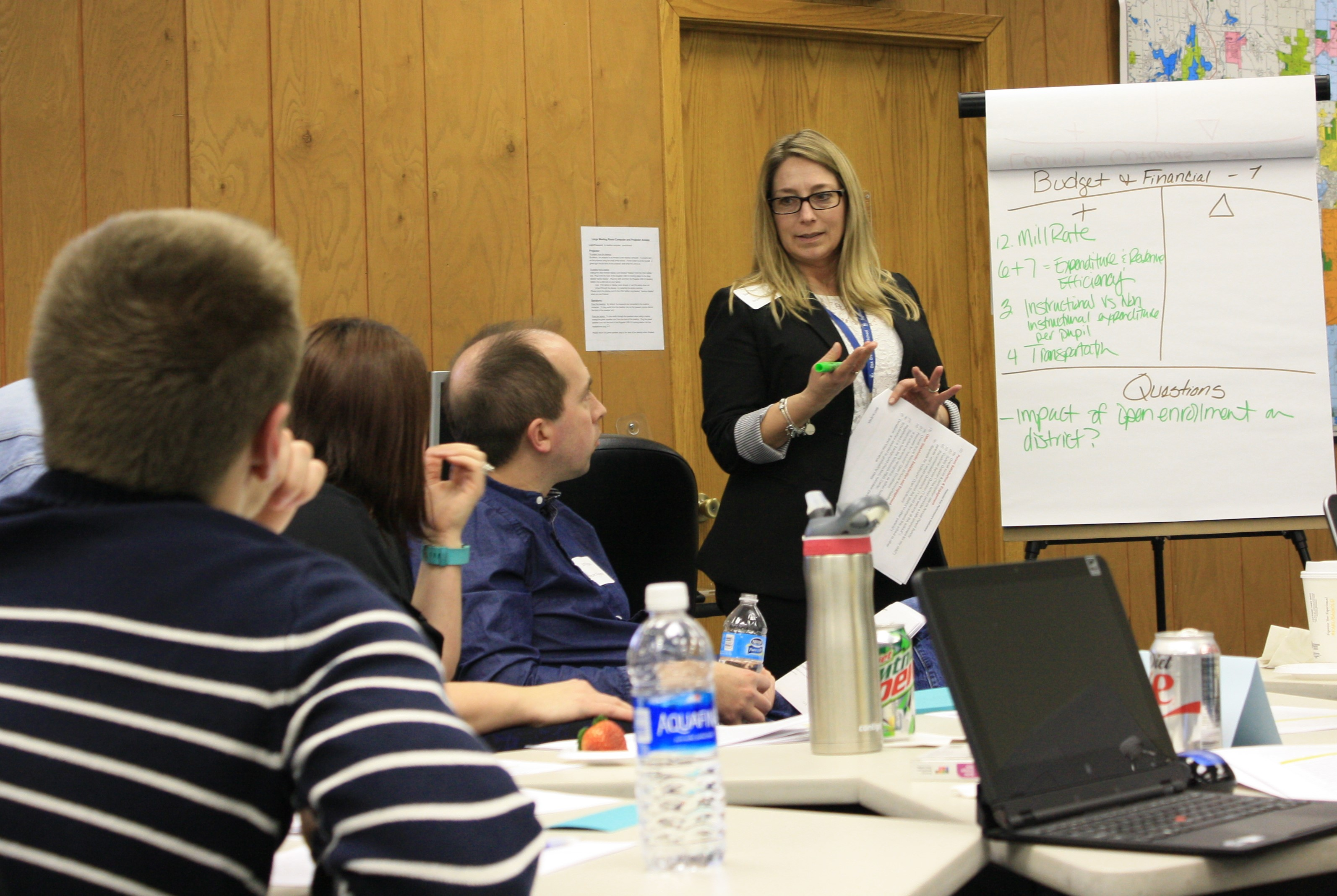 DLT member presenting in front of a table