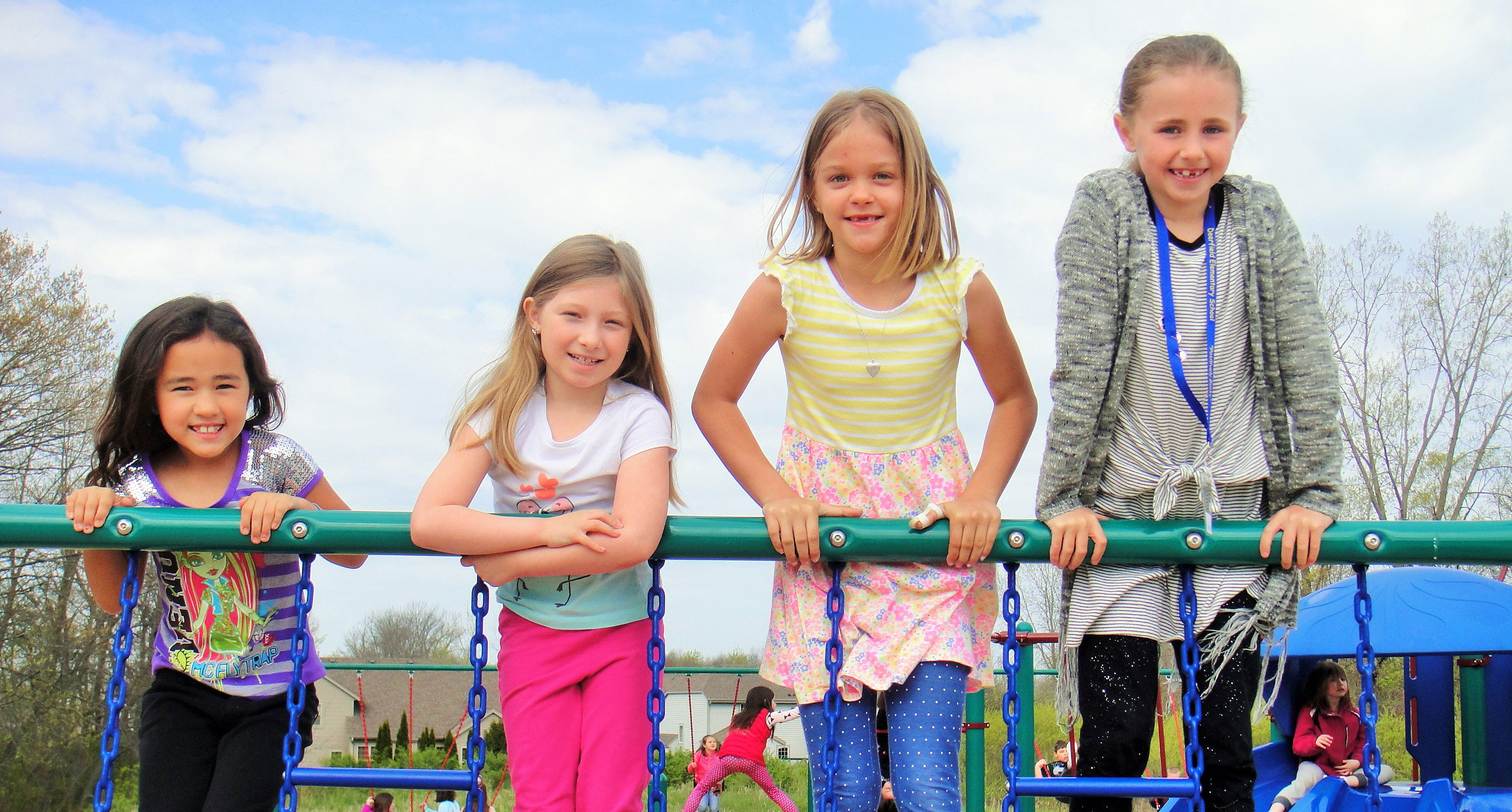 four girls playing on playground